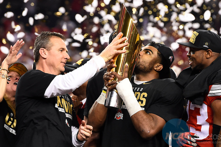 12 JAN 2015: Head Coach Urban Meyer and Ezekiel Elliott (15) of the Ohio State University celebrate after defeating the University of Oregon during the College Football Playoff National Championship held at AT&T Stadium in Arlington, TX.  Ohio State defeated Oregon 42-20 for the national title.  Jamie Schwaberow/NCAA Photos