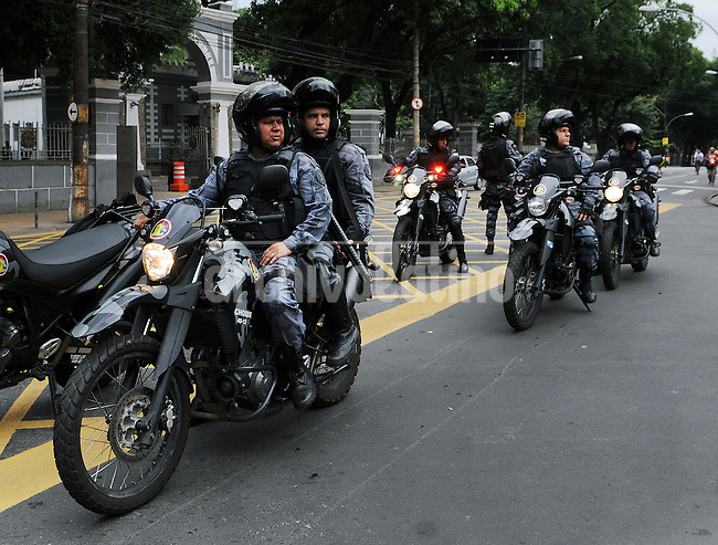 Policemen on motorcycle patrol streets near Maracana stadium where protesters are gathered in Rio de Janeiro, Brazil, June 30, 2013. Around 4,000 people gathered to denounce corruption, poor public services despite a heavy tax burden, and also the billions of dollars spent to host the World Cup and the 2016 Olympics in Rio - money they say should be going toward better hospitals, schools, transportation projects and schools. (Austral Foto/Renzo Gostoli)<br /> <br /> <br /> <br /> <br /> <br /> A demonstrator participates in a protest in Rio de Janeiro, Brazil, 30 June, 2013. Around 4,000 people gathered to denounce corruption, poor public services despite a heavy tax burden, and also the billions of dollars spent to host the World Cup and the 2016 Olympics in Rio - money they say should be going toward better hospitals, schools, transportation projects and schools. (Austral Foto/Renzo Gostoli)