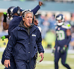 Seattle Seahawks  head coach Pete Carroll looks at a replay on the big screen during their NFC Championship game against the Green Bay Packers  at CenturyLink Field in Seattle, Washington on January 18, 2015.  The Seattle Seahawks beat the Green Bay Packers in overtime 28-22 for the NFC Championship Seattle.  ©2015. Photo by Jim Bryant, All Rights Reserved.