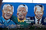 SOWETO, SOUTH AFRICA : Mandela murals close to Regina Mundi church in Soweto, South Africa. Soweto today is a mix of old housing and newly constructed townhouses. A new hungry black middle-class is growing steadily. Many residents work in Johannesburg but the last years many shopping malls have been built, and people are starting to spend their money in Soweto. ( Per-Anders Pettersson)