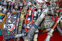 Prayer wheels, masks, for sale, Barkhor Square, Lhasa, Tibet.