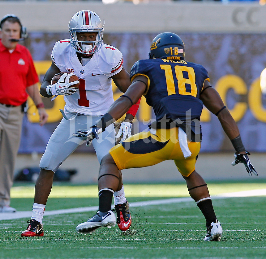 Ohio State Buckeyes running back Dontre Wilson (1) tries to get past California Golden Bears defensive back Joel Willis (18) in the 2nd quarter at Memorial Stadium in Berkeley, California on September 14, 2013.  (Dispatch photo by Kyle Robertson)
