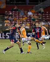 Atlante FC defender Andres Carevic (20) and Houston Dynamo  midfielder Brian Mullan (9). Houston Dynamo defeated Atlante FC 4-0 during the group stage of the Superliga 2008 tournament at Robertson Stadium in Houston, TX on July 12, 2008.