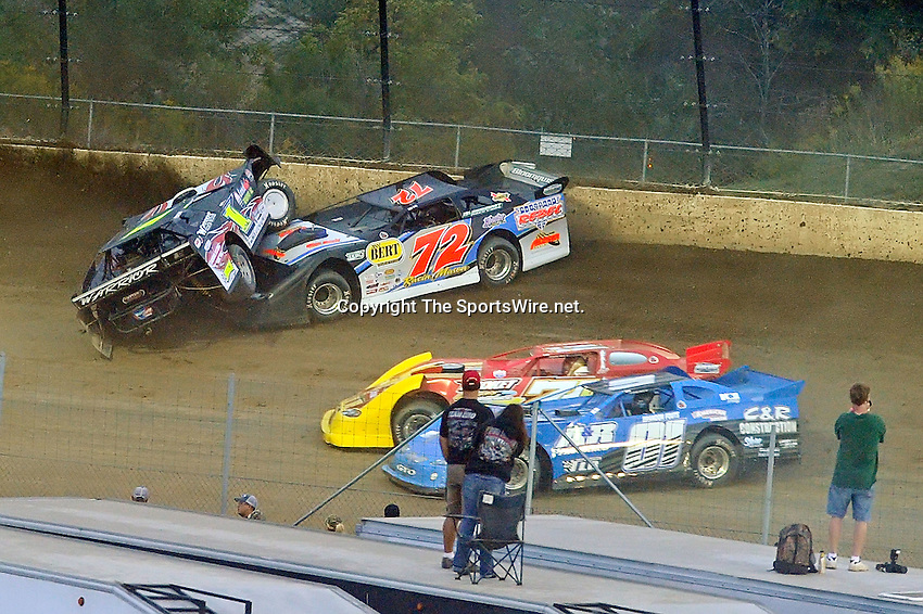 Sep 10, 2011; 7:48:34 PM; Rossburg, OH., USA; The 41st annual running of the World 100 Dirt Late Models racing for the Globe trophy at the Eldora Speedway.  Mandatory Credit: (thesportswire.net)
