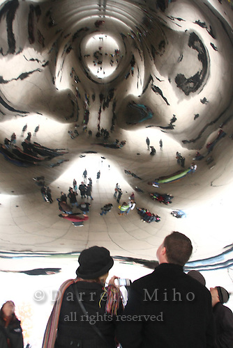 Nov. 08, 2008; Chicago, IL - Reflections of visitors dot the Cloud Gate sculpture (aka: the Bean) by sculptor Anish Kapoor at Millenium Park...Photo credit: Darrell Miho