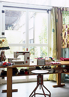 This practical workroom is dedicated to sewing and painting