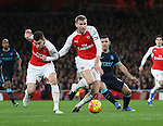 Arsenal's Laurent Koscielny and Per Mertesacker tussle with Manchester City's Sergio Aguero<br /> <br /> Barclays Premier League- Arsenal vs Manchester City - Emirates Stadium - England - 21st December 2015 - Picture David Klein/Sportimage