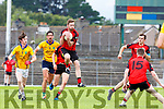 Donal O'Connor Kenmare Shamrocks fields the ball ahead of Anthony Maher and aaron O'Connor  Feale Rangers during the SFC clash in Fitzgerald Stadium on Sunday