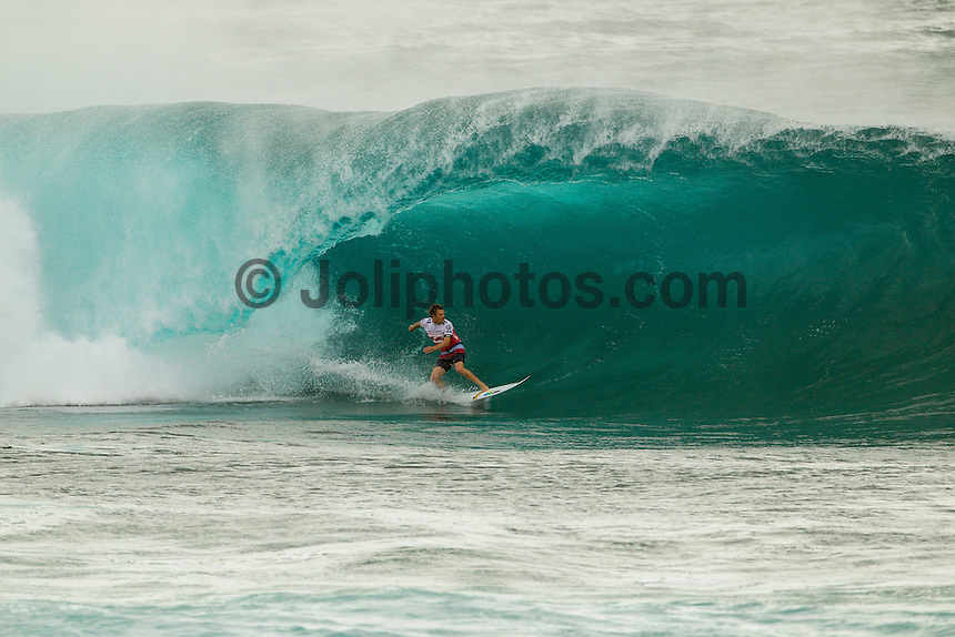 HONOLULU, Oahu, Banzai Pipeline - (Saturday, December 8, 2012) Dane Reynolds (USA). -- The Billabong Pipe Masters got underway on the very first day of the 12 day waiting period in a 5'-10' west swell. The contest kissed off at 11am as the new swell started to fill in. By mid afternoon there were 10' plus 2nd reef sets. There were pumping waves for all the heats. Upsets of the day included local Surfer Kalani Chapman (HAW) defeating Tiago Pires (PRT) and Cj Hobgood (USA) eliminating local hero and former event winner Jamie O'Brien (HAW)..All of Round 1 and three heats of Round 2 were completed. All three surfers in the running for the 2012 World Title, Joel Parkinson (AUS), Kelly Slater (USA) and Mick Fanning (AUS) did not surf today as they are seeded into the 3rd round. .Photo: joliphotos.com