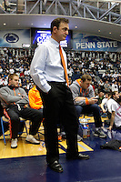 STATE COLLEGE, PA - FEBRUARY 16: Head coach John Smith of the Oklahoma State Cowboys watches his team warm-up before a match against the Penn State Nittany Lions on February 16, 2014 at Rec Hall on the campus of Penn State University in State College, Pennsylvania. Penn State won 23-12. (Photo by Hunter Martin/Getty Images) *** Local Caption *** John Smith