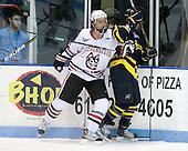 Brodie Reid (Northeastern - 15), Elliott Sheen (Merrimack - 11) - The visiting Merrimack College Warriors defeated the Northeastern University Huskies 4-3 (OT) on Friday, February 4, 2011, at Matthews Arena in Boston, Massachusetts.