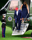 United States President Donald J. Trump and first lady Melania Trump return to the South Lawn of the White House in Washington, DC from their European trip on Friday, June 7, 2019.<br /> Credit: Ron Sachs / CNP