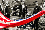 American Flag that had been draped over 9/11 monument made with steel from World Trade Center, at the Merrick Post #1282 American Legion Tenth Annivesary of 9/11 event, are American Legion Adjutant Robert Tom Riordan PCC and North Merrick Fire Dept. Ex. Chief Henry Hinrichs, at Merrick Veterans Memorial Park, Merrick, New York, USA, on September 11, 2011.