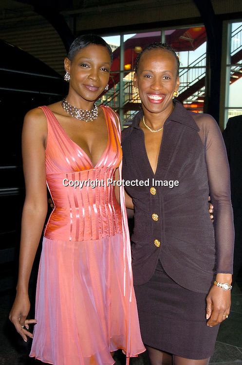 Roshumba Williams and Jackie Joyner-Kersee ..at the Arthur Ashe Institute for Urban Health Sportsball 2004 on April 29, 2004 at PIer Sixty at Chelsea PIers. ..People were told to wear Blcak tie and sneakers. ..Photo by Robin Platzer, Twin Images
