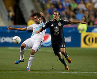 Graham Zusi (11) of the MLS All-Stars fights for the ball with Paulo Ferreira (19) of Chelsea during the game at PPL Park in Chester, PA.  The MLS All-Stars defeated Chelsea, 3-2.