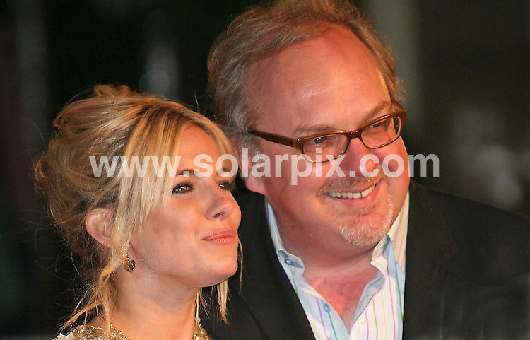 **ALL ROUND PICTURES FROM SOLARPIX.COM**.**WORLDWIDE SYNDICATION RIGHTS**.Sienna Miller and director George Hickenlooper attend the UK premiere of Factory Girl at Vue cinema, Leicester square, London...JOB REF:  3532     SSD     DATE: 13.03.07.**MUST CREDIT SOLARPIX.COM OR DOUBLE FEE WILL BE CHARGED* *UNDER NO CIRCUMSTANCES IS THIS IMAGE TO BE REPRODUCED FOR ANY ONLINE EDITION WITHOUT PRIOR PERMISSION*