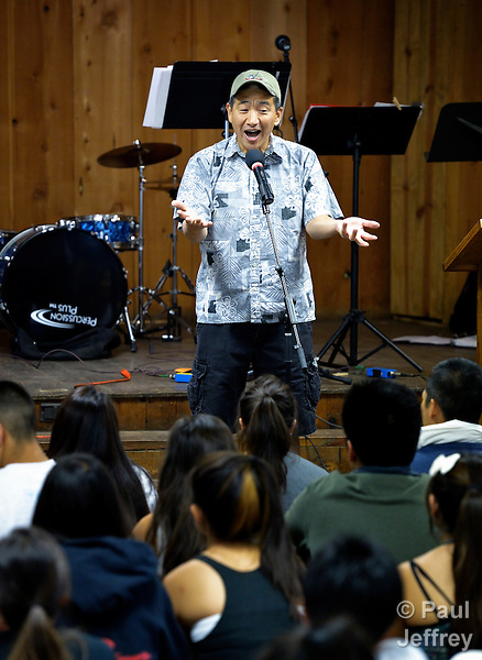 The Rev. Derek Nakano, pastor of Blaine Memorial United Methodist Church in Seattle, preaches to youth at the 2013 Asian American Camp, held at Camp Sierra in Big Creek, California.