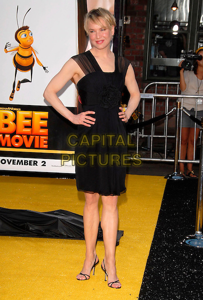 "RENEE ZELLWEGER.attends The Paramount Picture L.A. Premiere of ""Bee Movie"" held at The Mann's Village theatre in Westwood,  L.A. California, USA,  October 28 2007.                                                                      full length black dress hands on hips  yellow ring.CAP/DVS.©Debbie VanStory/Capital Pictures"