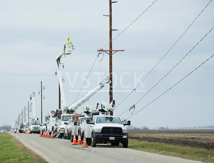 Electricians repairing power lines after tornado