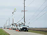 Electricians repairing power lines after tornado