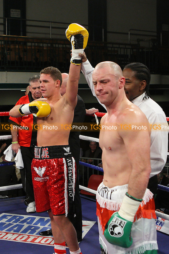 Billy Joe Saunders (red shorts) defeats Tommy Tolan in a Middleweight boxing contest at York Hall, Bethnal Green, promoted by Frank Warren - 14/12/11 - MANDATORY CREDIT: Gavin Ellis/TGSPHOTO - Self billing applies where appropriate - 0845 094 6026 - contact@tgsphoto.co.uk - NO UNPAID USE..