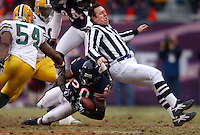 Umpire Jeff Rice gives the Green Bay Packers defense some unexpected help by stopping Bears running back Thomas Jones. (Photo by Rob Sumner)