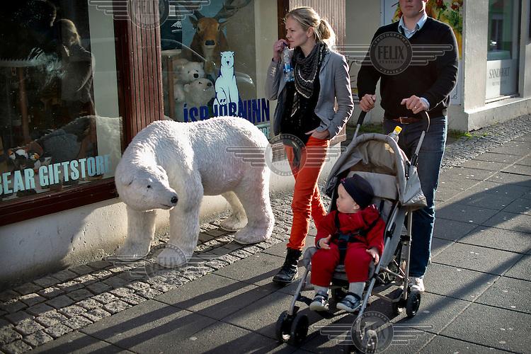 A family on Reykjavik's main shopping street.