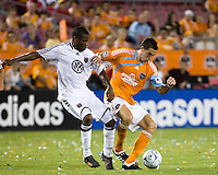 D.C. United defender Avery John (3) and Houston Dynamo midfielder Geoff Cameron (20) fight for control of the ball.  Houston Dynamo defeated D.C. United 4-3 at Robertson Stadium in Houston, TX on August 1, 2009.