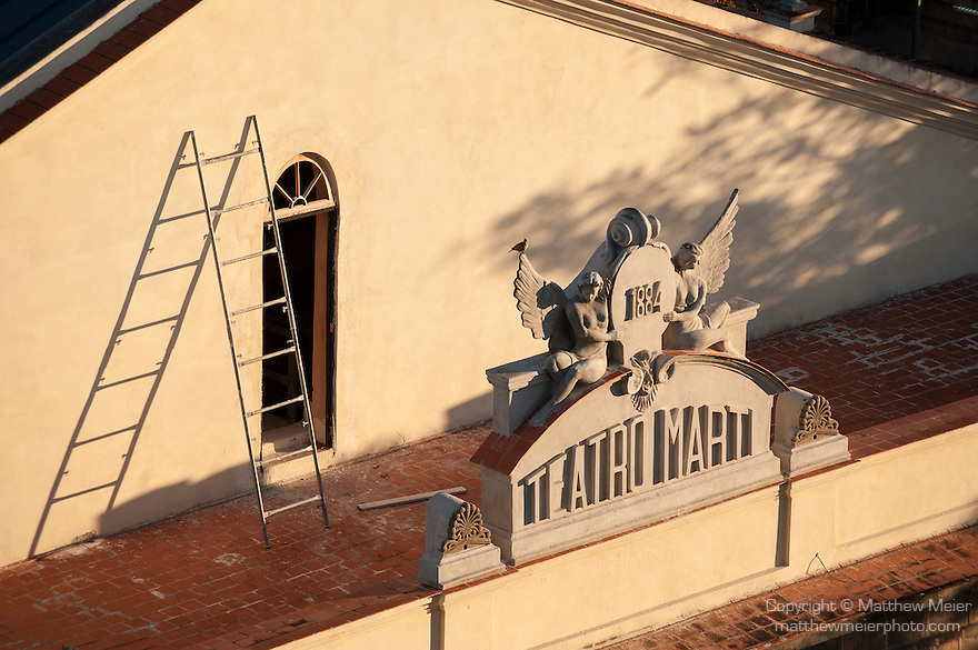Havana, Cuba; the baroque building signage on the roof of the Teatro Marti, viewed from above in early morning light