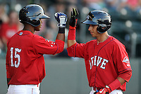 Javier Guerra (31) of the Greenville Drive, right, is congratulates by Joseph Monge (15) after scoring a run in a game against the Rome Braves on Friday, June 12, 2015, at Fluor Field at the West End in Greenville, South Carolina. Guerra is the No. 13 prospect of the Boston Red Sox, according to Baseball America. (Tom Priddy/Four Seam Images)