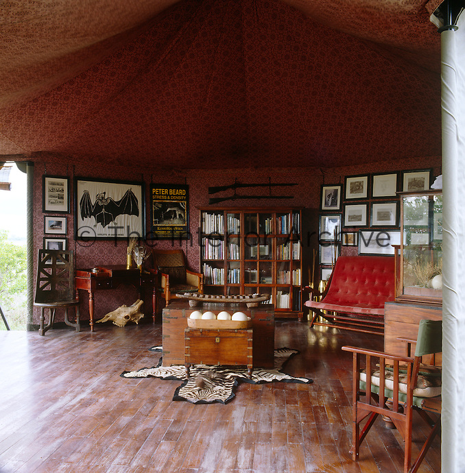 The library tent is a treasure trove of years of Botswana journals and tales of exploration of the area and the guns hanging above the display case were used by slave traders