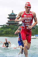 10 SEP 2011 - BEIJING, CHN - Andreas Giglmayr (AUT) (right) heads for transition after completing the swim during the 2011 Elite Mens ITU World Championship Series Grand Final Triathlon .(PHOTO (C) NIGEL FARROW)