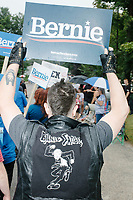 Supporters of Democratic presidential candidate and Vermont senator Bernie Sanders march in the Labor Day Parade in Milford, New Hampshire, on Mon., September 2, 2019. Candidates Bernie Sanders and Vermin Supreme were the only candidates who marched in the parade this year. Here, a person wears a leather jacket with an image of Bernie Sanders depicted as a ska rude boy skanking.