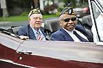 American Legionnaires, Booker T. Gibson at right, riding in classic car in Merrick Memorial Day Parade on May 28, 2012, on Long Island, New York, USA. America's war heroes are honored on this National Holiday.