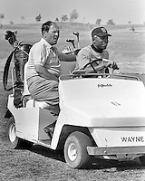 San Francisco Giants manager Herman Franks with his golfing buddy Willie Mays crusing along the golf course at the Giants Casa Grande Training facility.(1967 photo by Ron Riesterer)