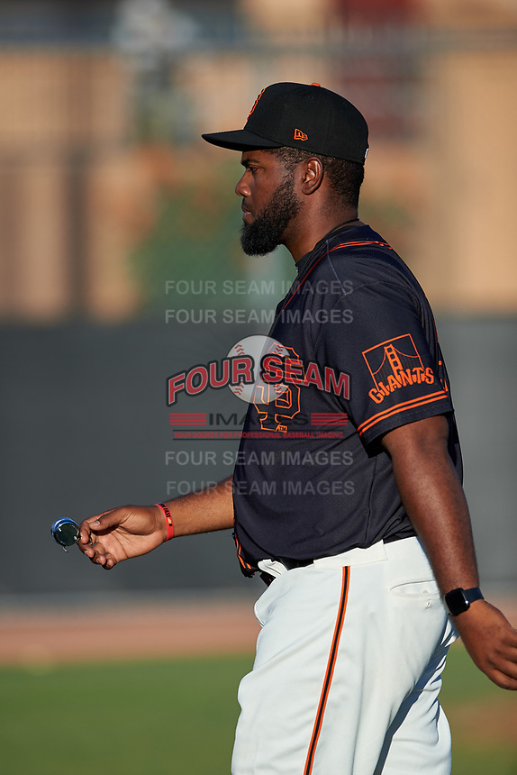 AZL Giants Black pitching coach Mario Rodriguez (54) walks towards the dugout after a visit to the mound during an Arizona League game against the AZL Angels at the Giants Baseball Complex on June 21, 2019 in Scottsdale, Arizona. AZL Angels defeated AZL Giants Black 6-3. (Zachary Lucy/Four Seam Images)