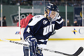 Damon Kipp (UNH - 4) - The University of Maine Black Bears defeated the University of New Hampshire Wildcats 5-4 in overtime on Saturday, January 7, 2012, at Fenway Park in Boston, Massachusetts.