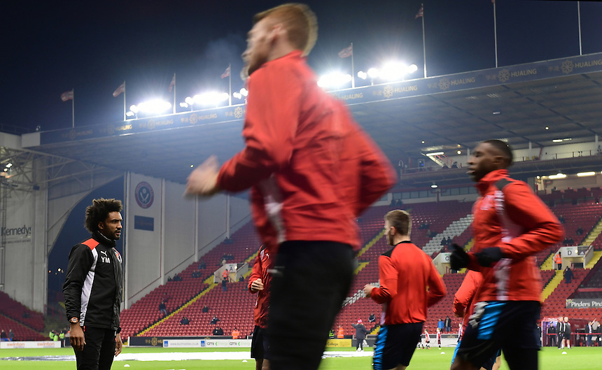 Fleetwood Town's sports scientist Youl Mawene, left, during the pre-match warm-up <br /> <br /> Photographer Chris Vaughan/CameraSport<br /> <br /> The EFL Sky Bet League One - Sheffield United v Fleetwood Town - Tuesday 24th January 2017 - Bramall Lane - Sheffield<br /> <br /> World Copyright &copy; 2017 CameraSport. All rights reserved. 43 Linden Ave. Countesthorpe. Leicester. England. LE8 5PG - Tel: +44 (0) 116 277 4147 - admin@camerasport.com - www.camerasport.com