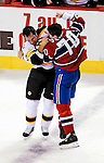 24 September 2009: Boston Bruins' left wing forward Guillaume Lefebvre fights with Montreal Canadiens' left wing forward Gregory Stewart in the first period at the Bell Centre in Montreal, Quebec, Canada. The Bruins edged out the Canadiens in an overtime shootout 2-1 in their pre-season matchup. Mandatory Credit: Ed Wolfstein Photo