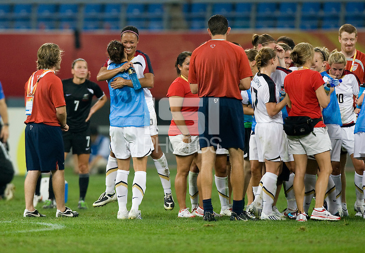 Kate Markgraf, Angela Hucles. The USWNT defeated New Zealand, 4-0, during the 2008 Beijing Olympics in Shenyang, China.  With the win, the USWNT won group G and advanced to the semifinals.