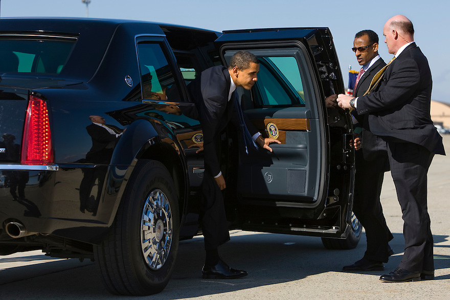 Secret Service agents hold the door for President Barack Obama as he gets out of the new Presidential limousine at  Andrews Air Force Base in Maryland...Photo by Brooks Kraft/Corbis........................
