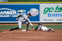 Wisconsin Timber Rattlers shortstop Antonio Pinero (3) applies the tag to Niko Hulsizer (40) on a stolen base attempt during a Midwest League game against the Great Lakes Loons at Dow Diamond on May 4, 2019 in Midland, Michigan. Great Lakes defeated Wisconsin 5-1. (Zachary Lucy/Four Seam Images)