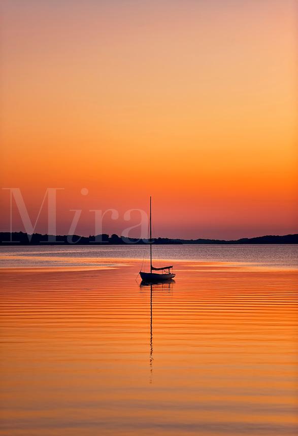 Sailboat at sunset, Cape Cod, MA, Massachusetts, USA