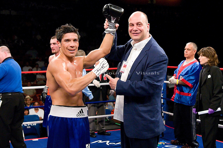 Uncasville, CT - June 7th, 2008: Sergio Martinez (blue/white trunk) in the ring with promoter Lou DiBella after his 8 rounds Super Welterweight fight against Archak Termeliksetian at the Mohegan Sun Casino. Martinez won by tko in the 7th round. Photo by Thierry Gourjon.