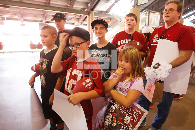 STANFORD,CA-- August 24, 2013: Fans line up for player autographs during the 2013 Stanford Football Open House Saturday afternoon at Stanford Stadium.