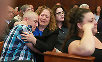 (06/26/2017- Boston, MA) Michael Sprinsky, far left,  gets a hug from his sister Laura Sprinsky as the guilty verdict is read for defendant Michael P. McCarthy (not pictured) for the first degree murder of  Bella Bond at Suffolk Superior Court on Monday, June 26, 2017. Staff Photo by Matt West