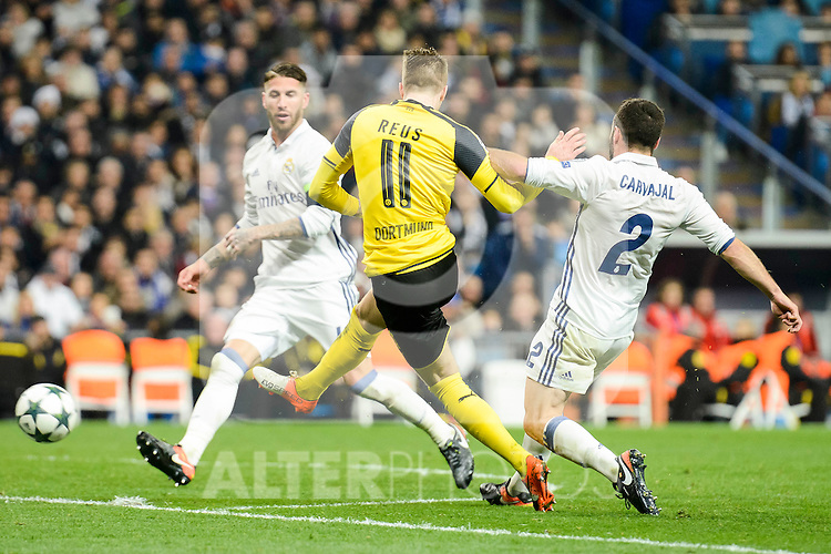 Real Madrid's Sergio Ramos and Daniel Carvajal and Borussia Dortmund Marco Reus during the UEFA Champions League match between Real Madrid and Borussia Dortmund at Santiago Bernabeu Stadium in Madrid, Spain. December 07, 2016. (ALTERPHOTOS/BorjaB.Hojas)