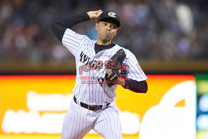 Charlotte Knights relief pitcher Jeanmar Gomez (9) in action against the Toledo Mud Hens at BB&T BallPark on June 22, 2018 in Charlotte, North Carolina. The Mud Hens defeated the Knights 4-0.  (Brian Westerholt/Four Seam Images)