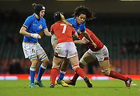 Italy&rsquo;s Giada Franco is tackled by Wales Amy Evans and  Beth Lewis <br /> <br /> Photographer Ian Cook/CameraSport<br /> <br /> 2018 Women's Six Nations Championships Round 4 - Wales Women v Italy Women - Sunday 11th March 2018 - Principality Stadium - Cardiff<br /> <br /> World Copyright &copy; 2018 CameraSport. All rights reserved. 43 Linden Ave. Countesthorpe. Leicester. England. LE8 5PG - Tel: +44 (0) 116 277 4147 - admin@camerasport.com - www.camerasport.com