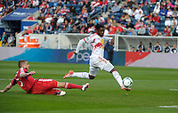 New York forward Peguy Luyindula (88) shoots after avoiding a challenge by Chicago defender Hunter Jumper (3).  The Chicago Fire defeated the New York Red Bulls 3-1 at Toyota Park in Bridgeview, IL on April 7, 2013.